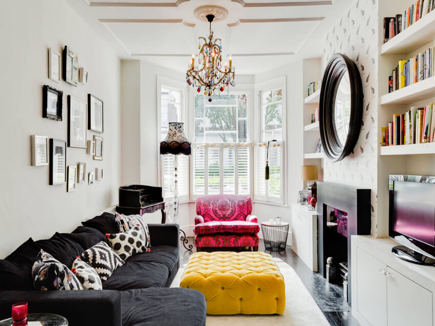a contemporary art deco living room with bold colored furniture, and Black and white ultra-stylish cushions