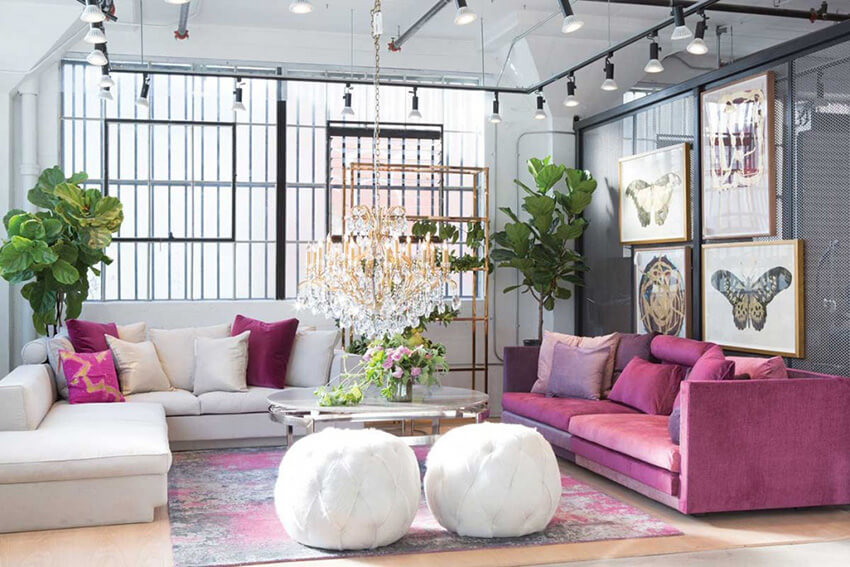 an art deco interior design with pink and white furniture and a pink-themed carpet