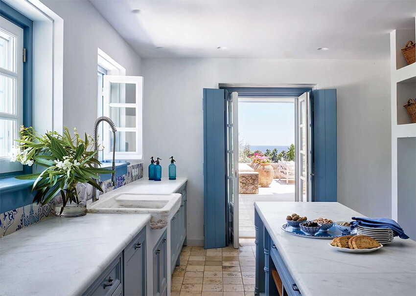 A kitchen with blue shades