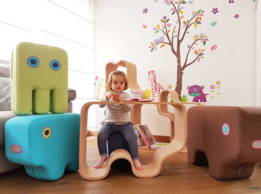 furniture in different shapes and colors in a kindergarten classroom