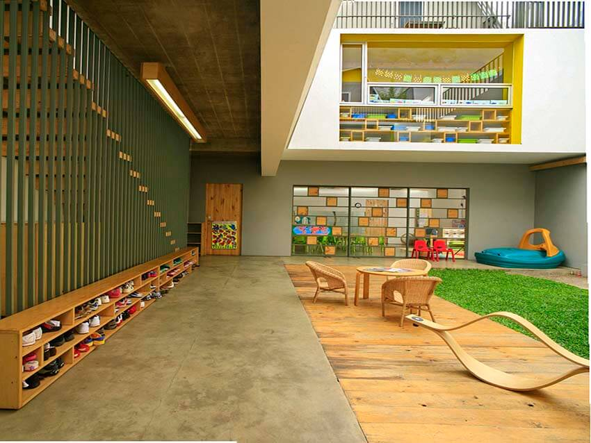 a modern kindergarten with green space and furniture