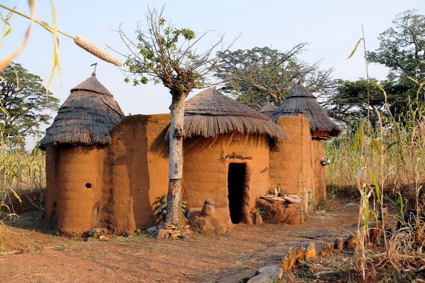 a native mud house with thatched roof as an indigenous African architecture