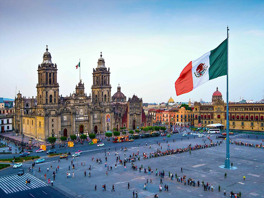 Traditional Mexican architecture with national flag-feature